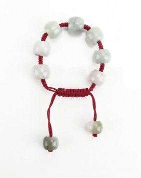 Chinese Jade Beaded Bracelet On Cord. Good Condition.