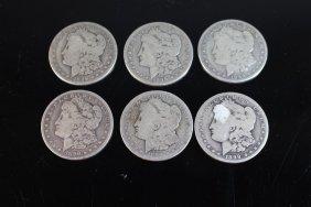 Six 1899-o Morgan Dollars