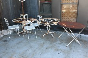 Iron Tables Along With Chairs With Daisy