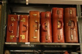Six Vintage Brown Leather Suitcases.