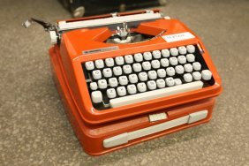 Hermes Rocket Orange Typewriter.