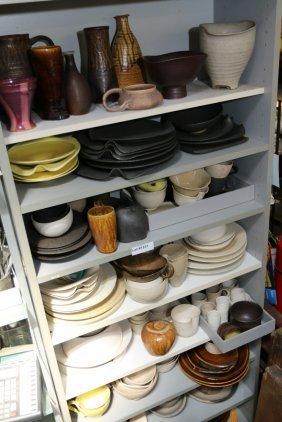 Nine Shelves Of Studio Pottery.