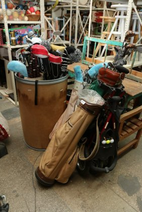 Large Assortment Of Golf Clubs And Tee's.