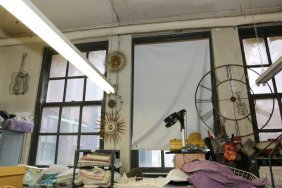Three Large Wall Clocks Along With A Wire Guitar