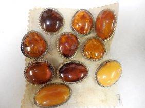 Eleven (11) Russian Amber Pins
