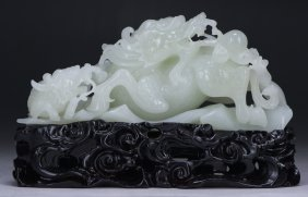 A Chinese Nephrite White Jade Qilin Group