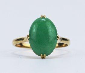 An Apple Green Jadeite Ring, 14k Gold