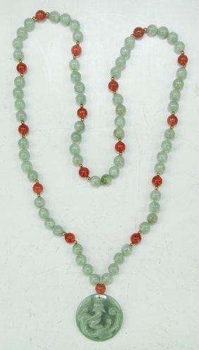 A Jadeite And Carnelian Agate Necklace