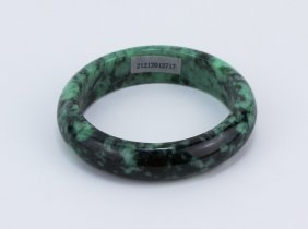 A Jadeite Bangle With Certificate