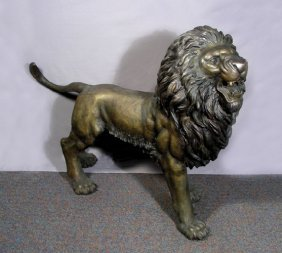 OUTSTANDING LIFE SIZE BRONZE SCULPTURE OF A LION