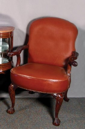 HAND CRAVED ENGLISH MAHOGANY AND LEATHER ARMCHAIR
