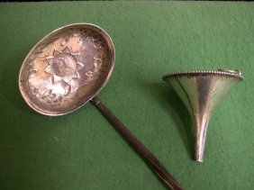 Silver Ladle And A Wine Funnel