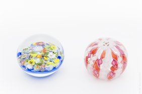 (2) Lundberg Studios Art Glass Paperweights.