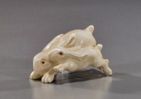 Carved Ivory Netsuke: Running Rabbits
