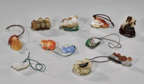 GROUP OF 11 CARVED AGATE TOGGLES