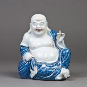 A Porcelain Buddha Sculpture