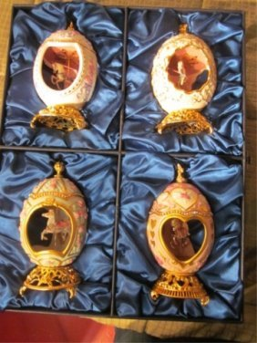FOUR FABERGE EGG STYLE MUSIC BOXES WITH CAROUSEL HO