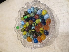 CUT CRYSTAL BOWL FILLED WITH MURANO ART GLASS EGGS,