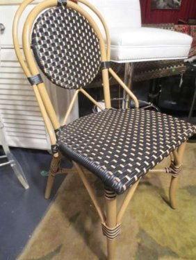 NEW NEVER USED DCOTA DESIGNER. RATTAN LOOK CHAIR, WO