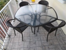 PATIO TABLE AND FOUR ARMCHAIRS BY EBEL OUTDOOR FURN