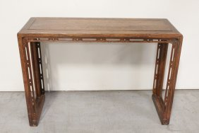 A Fine Chinese Huanghuali Wood Scroll Table