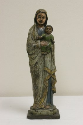 A Painted Wood Santos Depicting Maria And Jesus