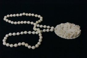 Ivory Pendant Attached To An Ivory Bead Necklace