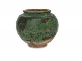 A Chinese Cizhou Green Glazed Sgraffiato Ovoid Vase,