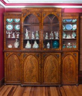 A Regency Gothic Mahogany Breakfront Bookcase 238 Cm