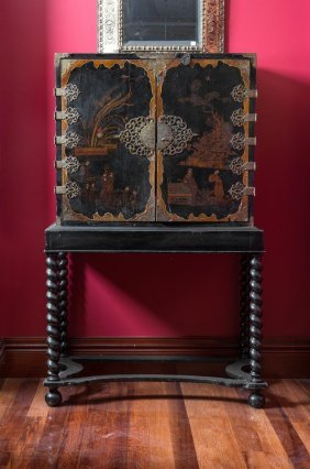 A Georgian Chinoiserie Black Lacquer Cabinet On Stand