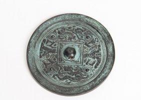 A Chinese Bronze Ming Dynasty Style Circular Mirror