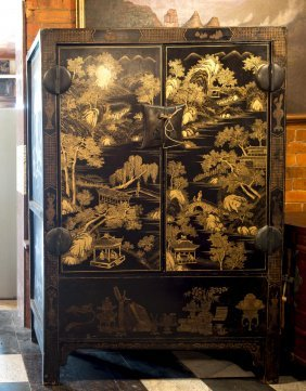 A Chinese Black Lacquer Two Door Cabinet Decorated With