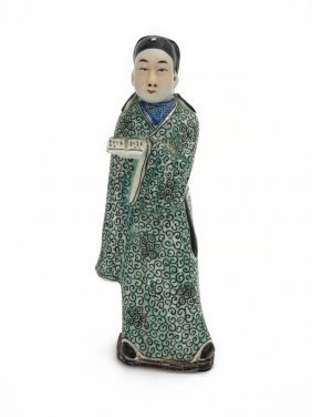A Chinese Porcelain Figure Of A Man In A Green Costume