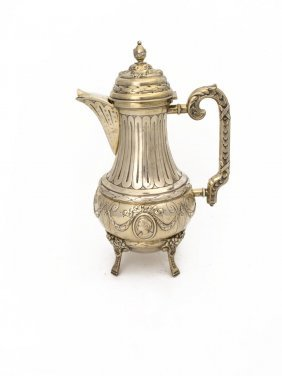 A French Silver Coffee Pot With Fluting Above Classical