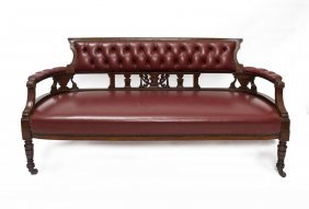 An Edwardian Settee With Buttoned Red Leather