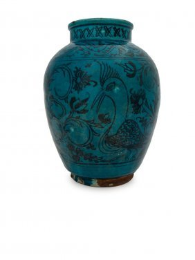 A Persian Turquoise Glazed Vase Decorated With A Bird