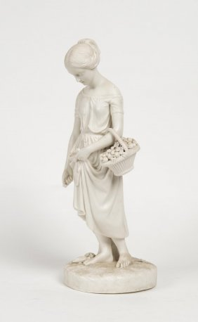 A Victorian Parian Figure Of A Young Girl Holding A
