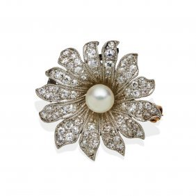 An Edwardian Diamond And Pearl Daisy Brooch. Yellow