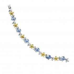 A Blue And Yellow Sapphire Bracelet, Butterfly And
