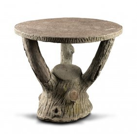 A Cement Garden Table In The Form Of A Tree Trunk With