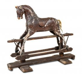 A Charming Painted And Carved Wooden Rocking Horse With