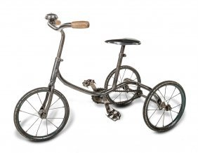 A Steel Child's Tricycle, 57cm High, 75cm Wide