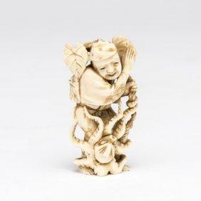 An Ivory Netsuke Of A Man With An Octopus, Meiji