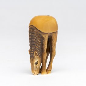 An Ivory Netsuke Of A Grazing Horse With Inset Eyes,