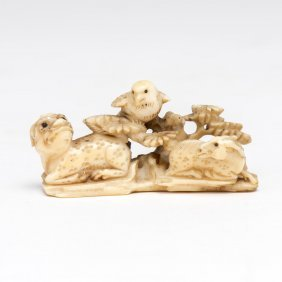 An Ivory Netsuke Of A Sparrow Looking Down On A