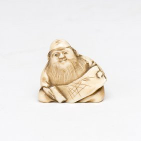 An Ivory Netsuke Of A Seared Sage Holding A Scroll,