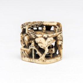 An Ivory Netsuke Of A Pavilion Among Fir Trees, Signed,