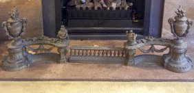 A Victorian Metal Fire Fender With Urns Supporting