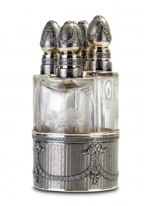 A French Silver Mounted Four Bottle Perfume Bottle