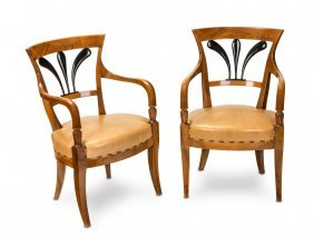 A Pair Of Neoclassical Ebonised Fruitwood Armchairs,